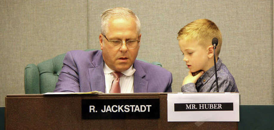 Listening intently to the mayor's instructions, Colin Huber, right, gets ready to open his first meeting as honorary mayor for the day in Glen Carbon Tuesday. Photo: Charles Bolinger | The Intelligencer