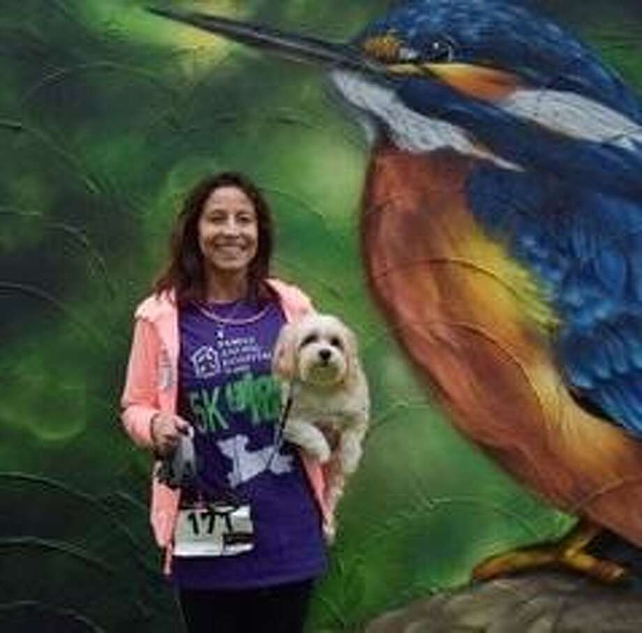 People and dogs who participated in last year's inaugural Zoo's Rezcue Paw Wars 5K Fun Run in Friendswood raised about $2,000 for pet rescue efforts. This year's event will be May 4.