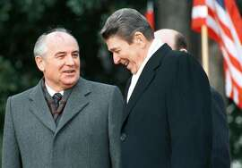 Former U.S. President Ronald Reagan (R) stands with former Soviet leader Mikhail Gorbachev (L) during Gorbachev's arrival ceremony at the White House in Washington  in this December 8, 1987 file photo.  Gorbachev on June 6, 2004  praised Reagan as a partner on the world stage who made the key contribution to ending the Cold War between the nuclear superpowers. Reagan died on June 5 at his Los Angeles home at the age of 93. REUTERS/Gary Hershorn/Files  Ran on: 06-13-2004 President Ronald Reagan, Soviet leader Mikhail Gorbachev stand outside the White House in 1987.