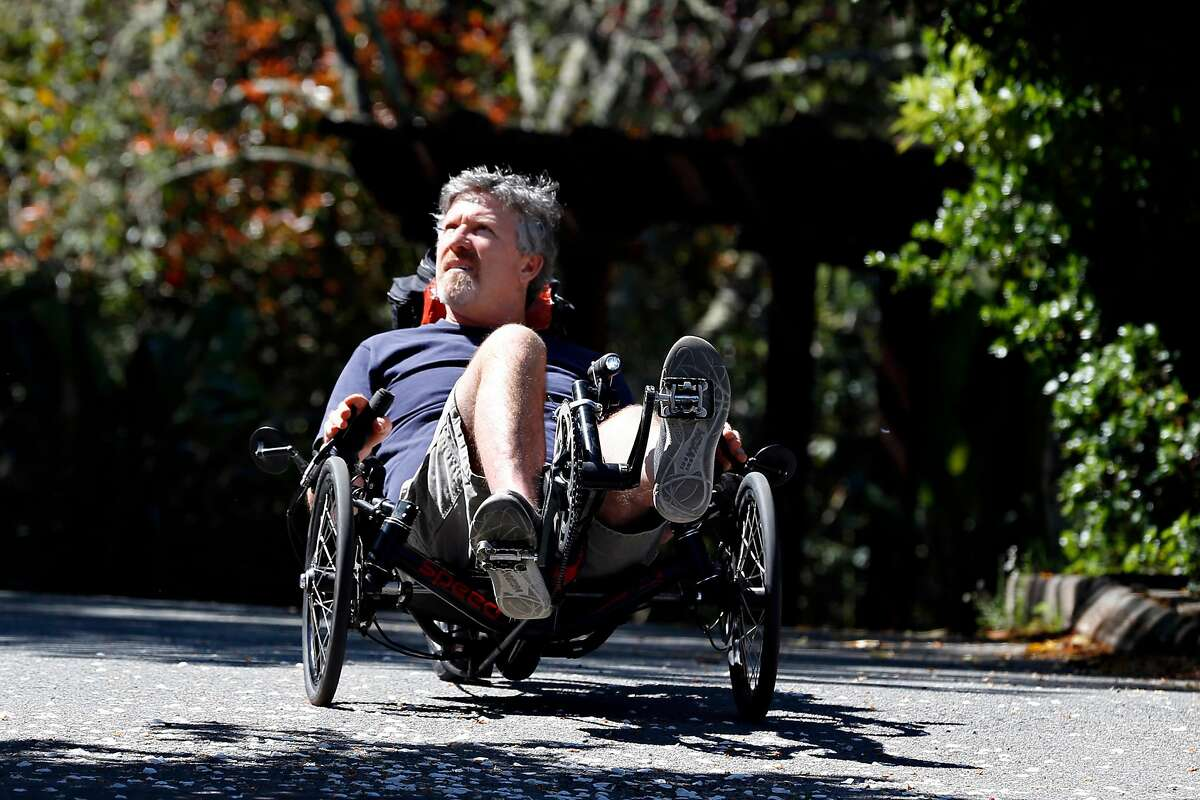 Miles McConnell trains on a recumbant bike, for an upcoming three-day fundraising ride for ALS, near his home in Larskpur, Calif. on Wednesday, April 24, 2019. UCSF researchers are developing a device that turns brain signals into synthetic speech, which would be a huge benefit to McConnell, who is losing his ability to speak because of ALS.