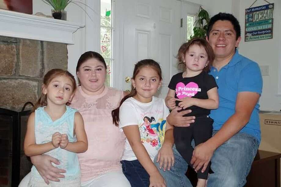 From left, Katina Robalino holds her daughter, Katalina Athena, seated next to her is daughter Anastacia Teresa, Eduardo Robalino, who is holding their daughter Elena Zoe, who at 4 years old has already had a heart transplant and cancer. Photo: Katina Robalino / Contributed Photo / CATHERINE*O