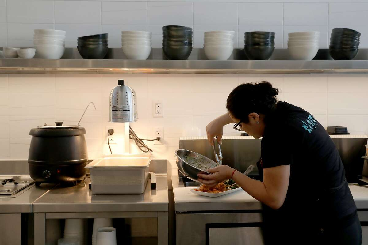 Brenda Juarez plates a dish at El Pipila, a Guanajuato restaurant on Tuesday, April 23, 2019, in San Francisco, Calif.