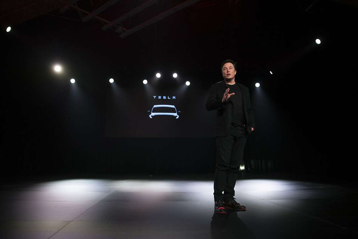 FILE - In this March 14, 2019, file photo Tesla CEO Elon Musk speaks before unveiling the Model Y at the company's design studio in Hawthorne, Calif. Tesla, Inc. reports earnings Wednesday, April 24. (AP Photo/Jae C. Hong, File)