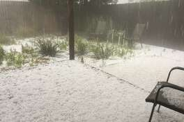 Hail covers the backyard of a home at Wadley Avenue and Midkiff Road Tuesday night.