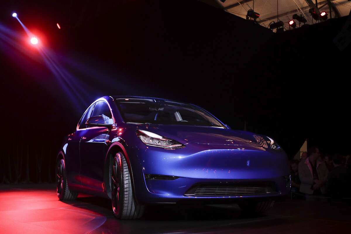 FILE- In this March 14, 2019, file photo the Tesla Model Y is unveiled at Tesla's design studio in Hawthorne, Calif. Tesla, Inc. reports earnings Wednesday, April 24. (AP Photo/Jae C. Hong, File)