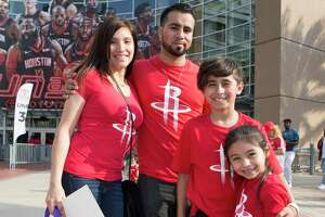 Houston Rockets fans pose for a photograph before Game 5 of first round of the NBA Playoffs game at Toyota Center on Wednesday, April 24, 2019, in Houston.