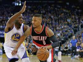 Damian Lillard #0 of the Portland Trail Blazers drives on Draymond Green #23 of the Golden State Warriors at ORACLE Arena on April 3, 2016 in Oakland, California.