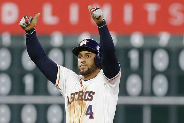 HOUSTON, TEXAS - APRIL 23: George Springer #4 of the Houston Astros doubles in a run in the fifth inning against the Minnesota Twins at Minute Maid Park on April 23, 2019 in Houston, Texas. (Photo by Bob Levey/Getty Images)