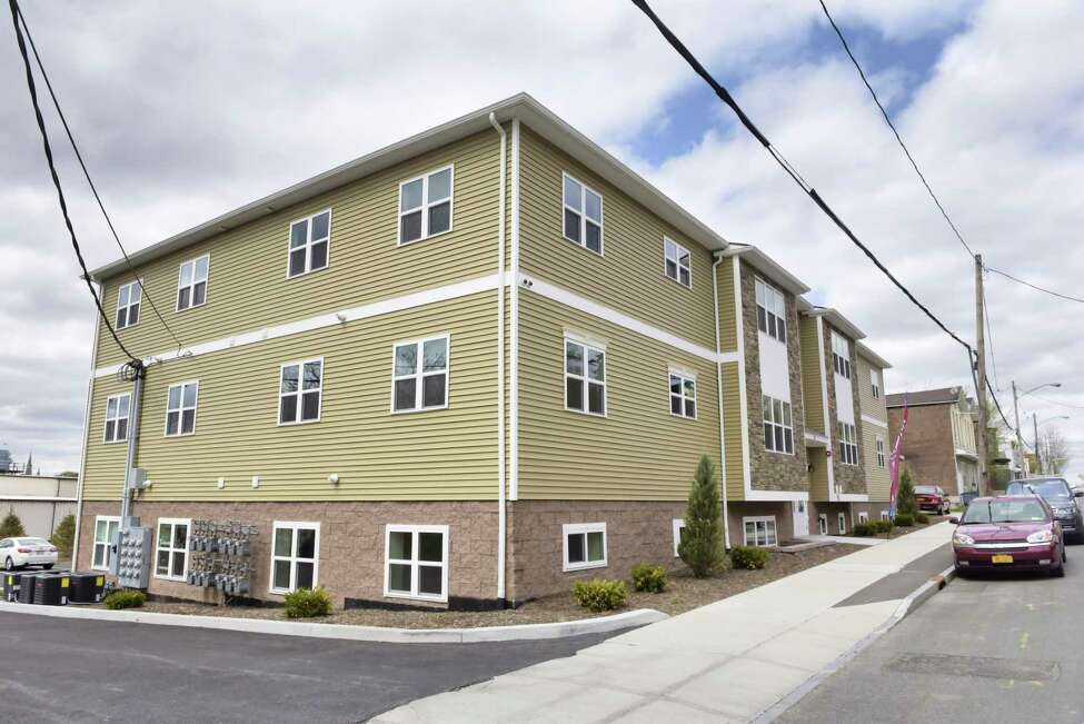 A view of the new 12-unit apartment building at 1047 Broadway on Wednesday, April 24, 2019, in Rensselaer, N.Y. This apartment, which was new construction built on an empty lot, is the first of three planned new construction apartment buildings on Broadway. The two-bedroom, roughly 970 square-feet apartments come with granite countertops and stainless steel appliances. (Paul Buckowski/Times Union)