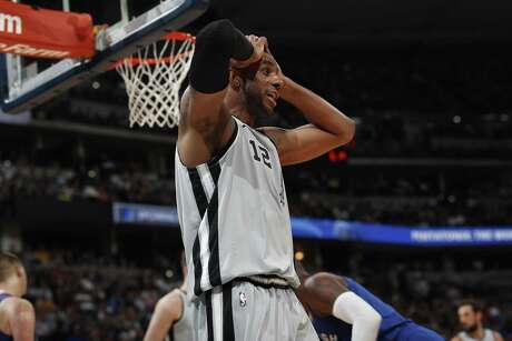 San Antonio Spurs center LaMarcus Aldridge (12) in the first half of Game 5 of an NBA basketball first-round playoff series Tuesday, April 23, 2019, in Denver. (AP Photo/David Zalubowski)