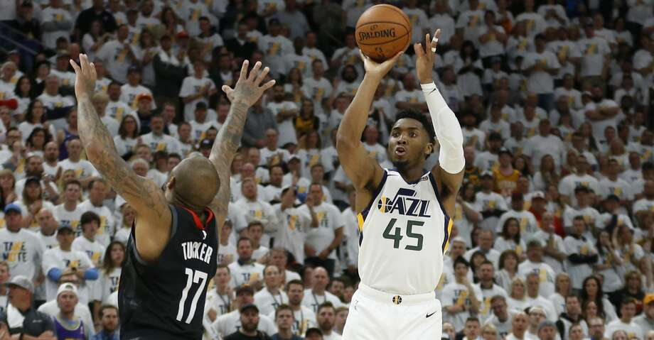 PHOTOS: Rockets game-by-game Utah Jazz guard Donovan Mitchell (45) shoots as Houston Rockets forward PJ Tucker (17) defends in the second half during Game 4 of a first-round NBA basketball playoff series Monday, April 22, 2019, in Salt Lake City. (AP Photo/Rick Bowmer) Browse through the photos to see how the Rockets fared in each game this season. Photo: Rick Bowmer/Associated Press