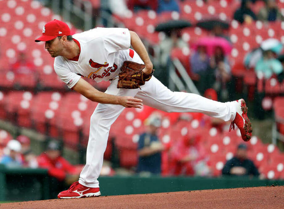 Cardinals starting pitcher Adam Wainwright throws during the first inning game against the Milwaukee Brewers Wednesday in St. Louis. Photo: AP