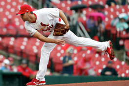 Cardinals starting pitcher Adam Wainwright throws during the first inning game against the Milwaukee Brewers Wednesday in St. Louis.