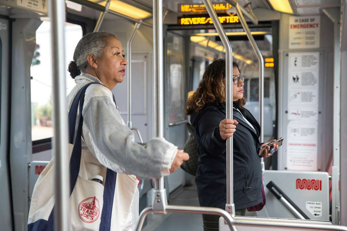 Ida Jackson, right, rides the T Muni line outbound train to Bayview�Hunters Point on Tuesday, April 16, 2019. San Francisco, Calif.