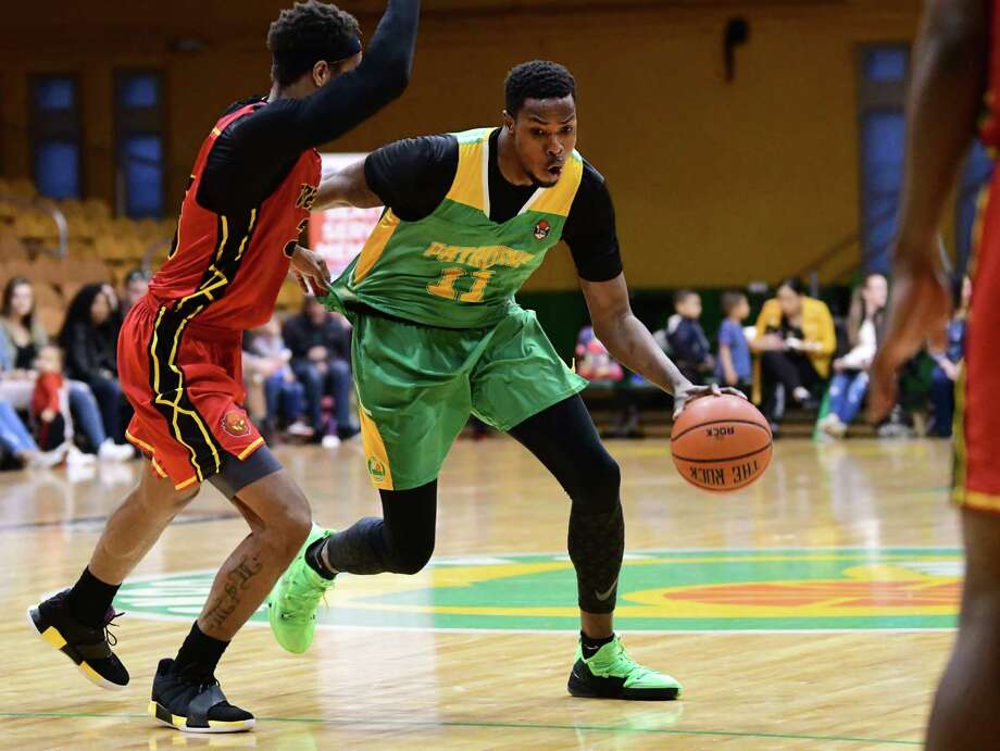 Albany Patroons' Darius Paul drives to the net against Raleigh Firebirds' Jamee Jackson during a basketball playoff game at the Washington Avenue Armory on Wednesday, April 24, 2019 in Albany, N.Y. (Lori Van Buren/Times Union) Photo: Lori Van Buren, Albany Times Union / 40046749A