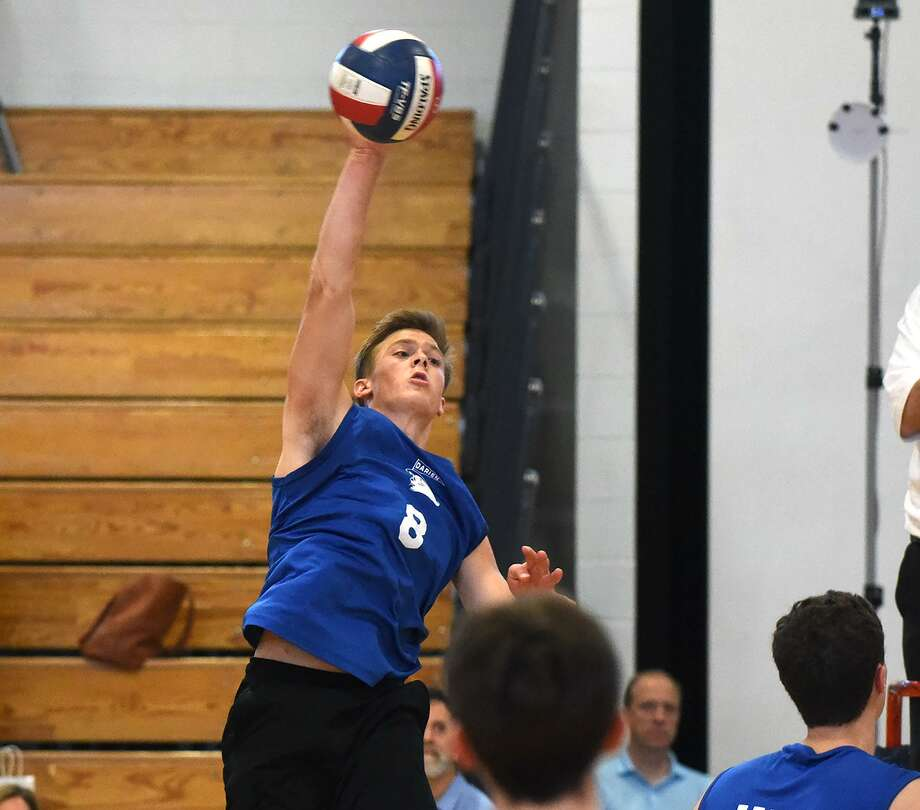Darien's Tyler Herget (8) puts down a shot during the Blue Wave's volleyball match against New Canaan on Wednesday. Photo: Dave Stewart / Hearst Connecticut Media / Hearst Connecticut Media