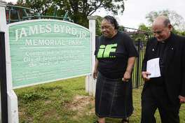 Father Ron Foshage walks with Betty Boatner, James Byrd Jr. sister, before the prayer vigil which held at James Byrd Memorial Park in Jasper on Wednesday. The vigil was held to prayer for John King as well as James Byrd. Photo taken on Wednesday, 04/24/19. Ryan Welch/The Enterprise