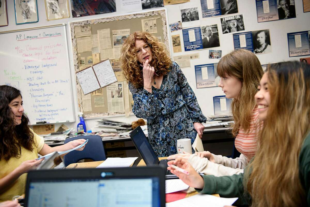 English teacher Kathi Duffel, the faculty adviser for the Bruin Voice student newspaper, works with students as they layout the paper at Bear Creek High School in Stockton, Calif, on Wednesday, April 24, 2019. The Stockton school district is threatening to fire Kathi Duffel, faculty adviser for the Bruin Voice student newspaper, if she doesn't show them a certain story in advance, violating the papers First Amendment freedom of the press rights.