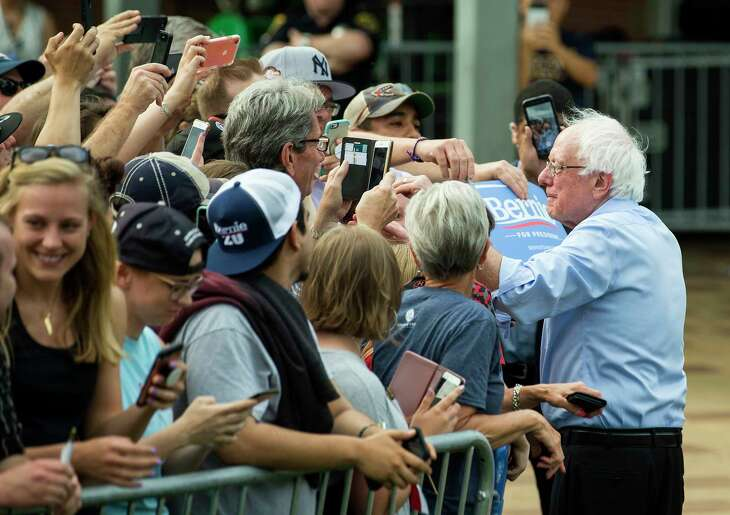 Democratic presidential hopeful Sen. Bernie Sanders shakes hands with supporters following a rally at Discovery Green on Wednesday, April 24, 2019, in Houston.