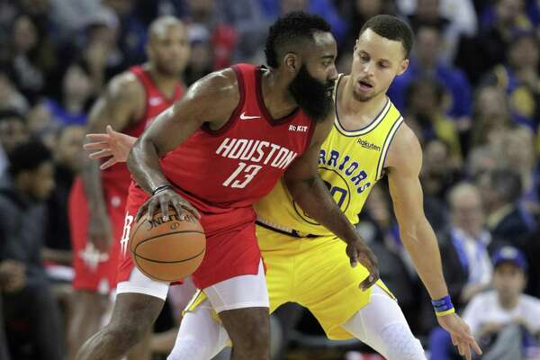 Stephen Curry (30) defends against James Harden (13) in the first half as the Golden State Warriors played the Houston Rockets at Oracle Arena in Oakland, Calif., on Thursday, January 3, 2019.