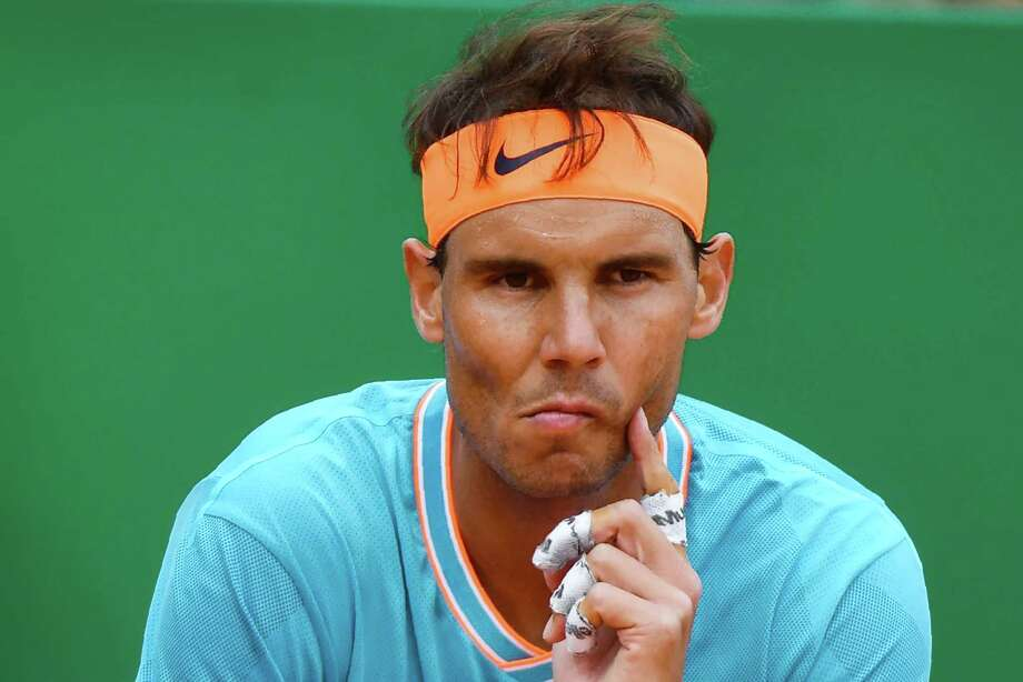 """(FILES) In this file photo taken on April 20, 2019 Spain's Rafael Nadal reacts during the semi final tennis match against Italy's Fabio Fognini at the Monte-Carlo ATP Masters Series tournament in Monaco. - Rafael Nadal admitted that it will be """"hard to return to the practice court"""" after a shock semi-final defeat by Fabio Fognini ended his bid for a record-extending 12th Monte Carlo Masters title on Saturday. The 17-time Grand Slam champion starts his Barcelona Open title defence on Wednesday April 24, 2019, as he also fights to keep his world-number-two ranking before the French Open gets underway next month. (Photo by YANN COATSALIOU / AFP)YANN COATSALIOU/AFP/Getty Images Photo: YANN COATSALIOU / AFP or licensors"""