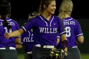Willis starting pitcher Ashley Vellejo (2) shares a laugh during the seventh inning in Game 1 of a Region III-5A bi-district softball playoff match, Wednesday, April 24, 2019, in Willis.