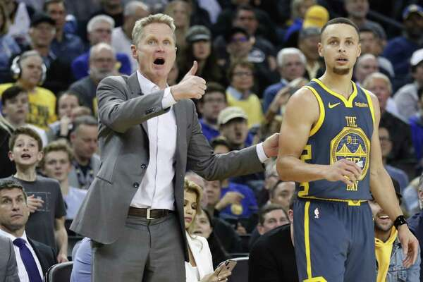 Golden State Warriors' head coach Steve Kerr and Stephen Curry look for a favorable call during 4th quarter of Philadelphia 76ers' 113-104 win in NBA game at Oracle Arena in Oakland, Calif., on Thursday, January 31, 2019.