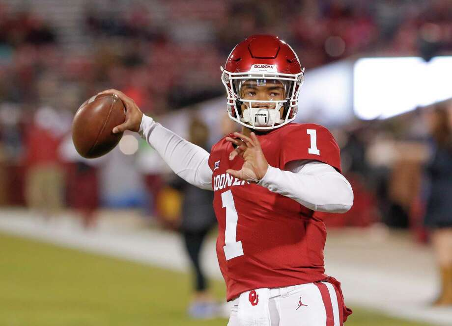 FILE - In this Saturday, Nov. 17, 2018 file photo, Oklahoma quarterback Kyler Murray (1) before the start of an NCAA college football game against Kansas in Norman, Okla. Kyler Murray suddenly has a bunch of new fans in the Oakland Athletics organization, even if they cringe watching Heisman Trophy winner play quarterback for Oklahoma. The A's don't want their prized first-round draft pick hurt on the football field because they are counting on him wearing an Oakland jersey come spring training. (AP Photo/Alonzo Adams, File) Photo: Alonzo Adams / Copyright 2018 The Associated Press. All rights reserved.