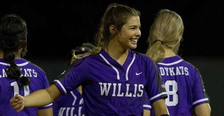 Willis starting pitcher Ashley Vallejo (2) shares a laugh during the seventh inning in Game 1 of a Region III-5A bi-district softball playoff match, Wednesday, April 24, 2019, in Willis.