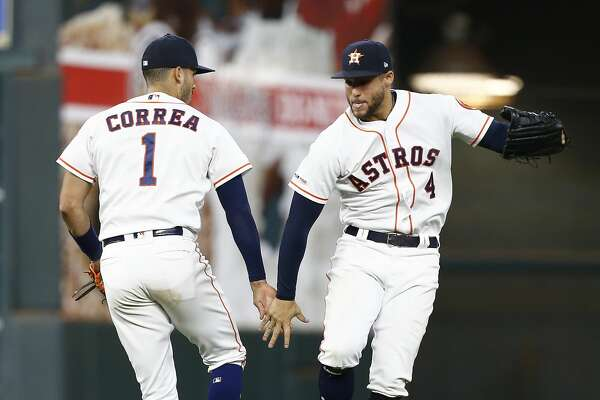 HOUSTON, TEXAS - APRIL 24: Carlos Correa #1 of the Houston Astros celebrates with George Springer #4 after defeating the Minnesota Twins 7-1 at Minute Maid Park on April 24, 2019 in Houston, Texas. (Photo by Bob Levey/Getty Images)