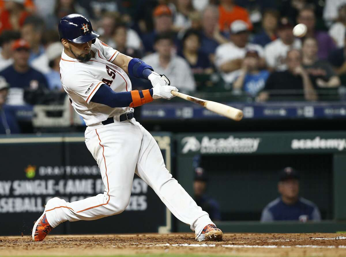 HOUSTON, TEXAS - APRIL 24: Robinson Chirinos #28 of the Houston Astros hits a double scoring a run in the fourth inning against the Minnesota Twins at Minute Maid Park on April 24, 2019 in Houston, Texas. (Photo by Bob Levey/Getty Images)