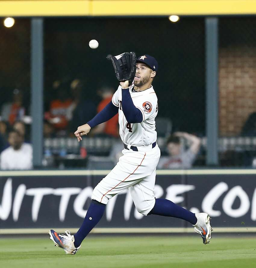 HOUSTON, TEXAS - APRIL 24: George Springer #4 of the Houston Astros catches a line drive hit by Jorge Polanco #11 of the Minnesota Twins in the sixth inning at Minute Maid Park on April 24, 2019 in Houston, Texas. (Photo by Bob Levey/Getty Images)