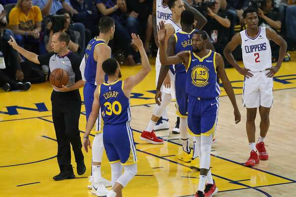 79ba296fd485 1of3Golden State Warriors Stephen Curry and Kevin Durant high five in the  first quarter during game 5 of the Western Conference Playoffs between the  Golden ...