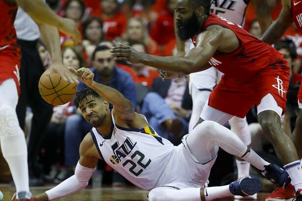 Utah Jazz forward Thabo Sefolosha (22) tries to hold onto a loose ball defended by Houston Rockets guard James Harden (13) during the third quarter of game 5 of the NBA playoffs at theToyota Center, in Houston, Wednesday, April 24, 2019.