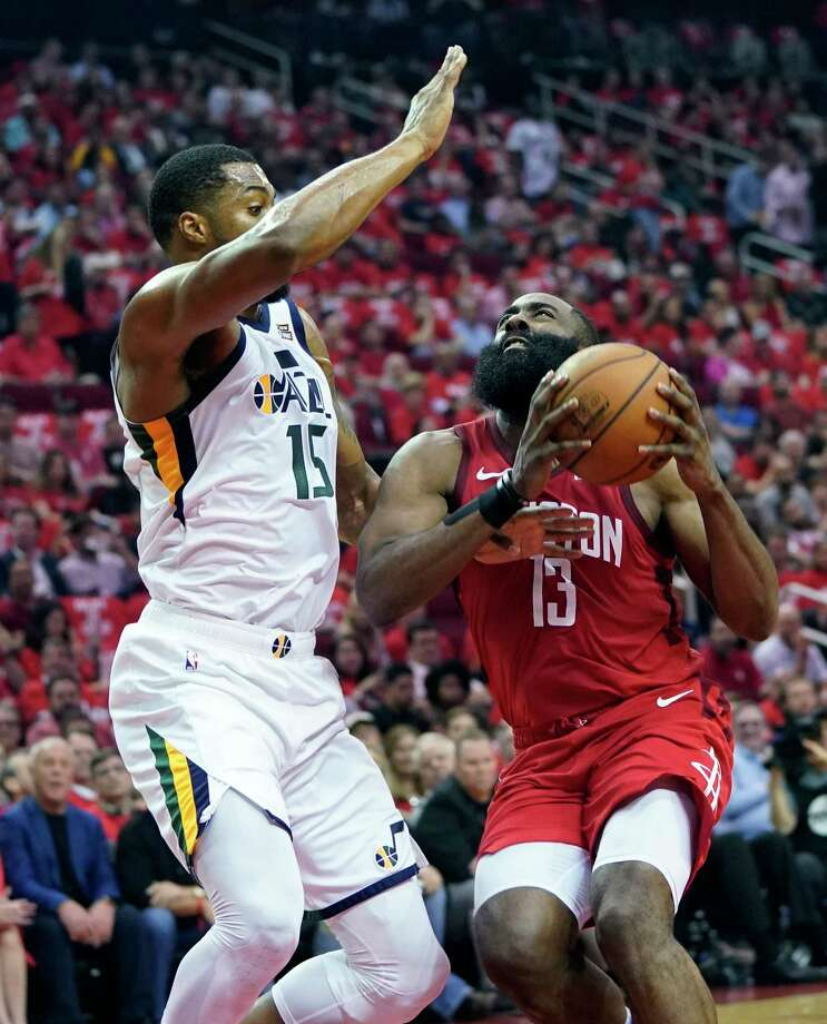 Houston Rockets guard James Harden (13) drives to the basket against Utah Jazz forward Derrick Favors (15) during the first half in Game 5 of an NBA basketball playoff series, in Houston, Wednesday, April 24, 2019. (AP Photo/David J. Phillip) Photo: David J. Phillip / Copyright 2019 The Associated Press. All rights reserved.
