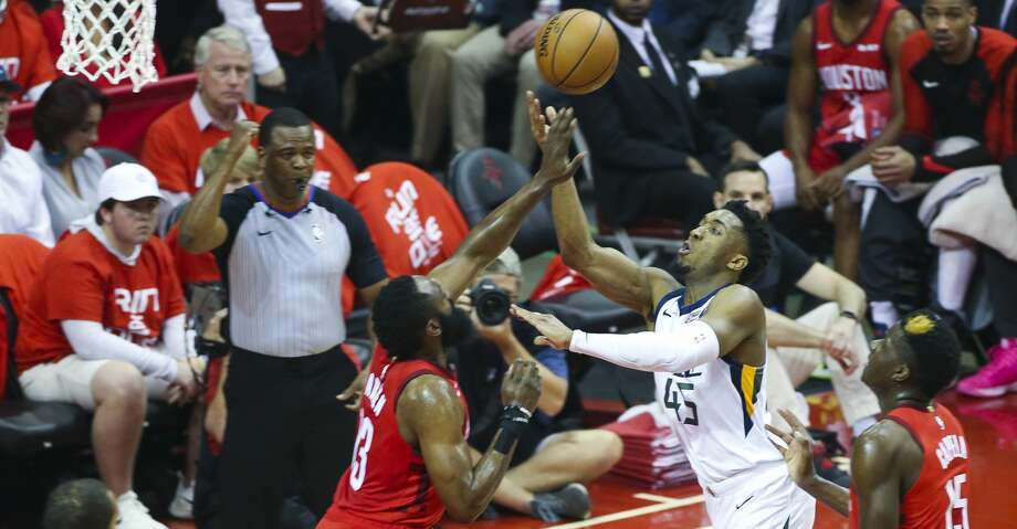 Utah Jazz guard Donovan Mitchell (45) shoots over Houston Rockets guard James Harden (13) during Game 5 of an NBA first round playoff series at Toyota Center in Houston, Wednesday, April 24, 2019. Photo: Elizabeth Conley/Staff Photographer