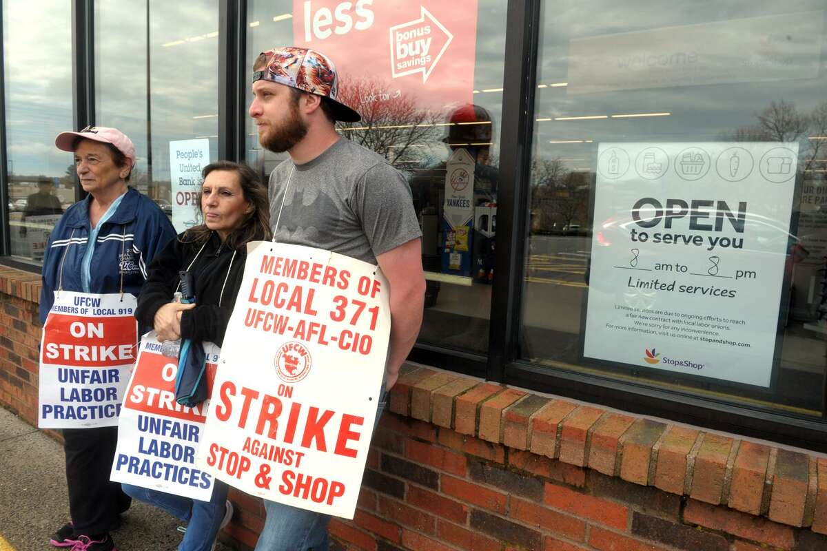 From left, striking workers Elaine Muro, Gina Migliore and Zach Terry stand on the picket line in front of the Stop & Shop on Bridgeport Ave., in Shelton, Conn. April 15, 2019. Monday marked the fifth day of strike.