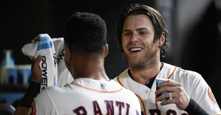 Houston Astros' Josh Reddick, right, celebrates his two-run home run off Minnesota Twins relief pitcher Fernando Romero with Michael Brantley during the eighth inning of a baseball game, Wednesday, April 24, 2019, in Houston. (AP Photo/Eric Christian Smith)