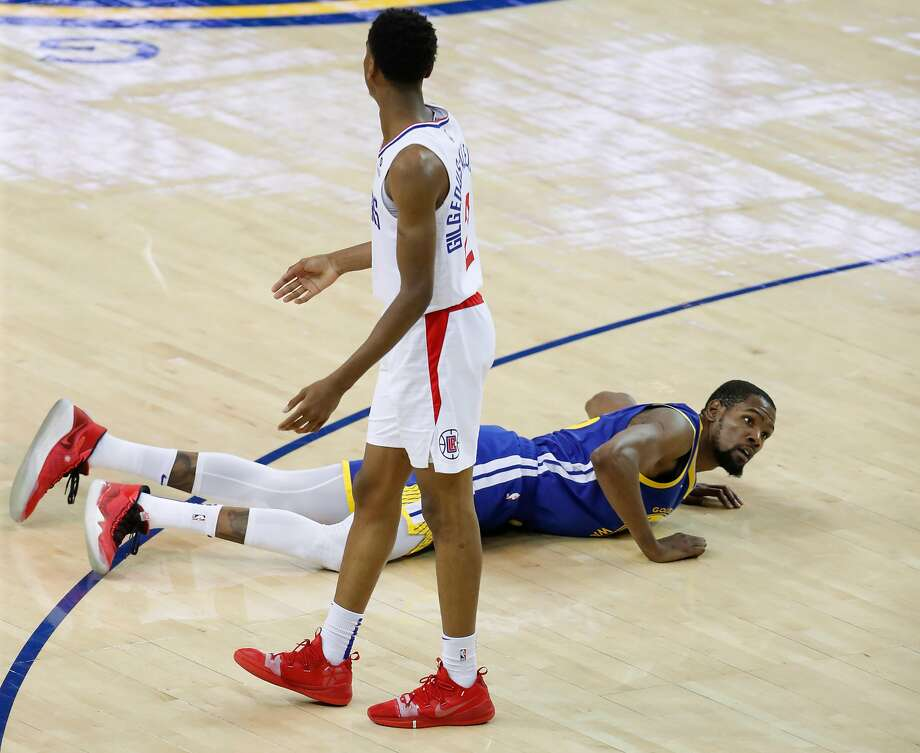 764012f4c15 Golden State Warriors Kevin Durant falls to the floor after being fouled by  Los Angeles Clippers
