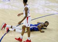 Golden State Warriors Kevin Durant falls to the floor after being fouled by Los Angeles Clippers Shai Gilgeous-Alexander in the third quarter during game 5 of the Western Conference Playoffs between the Golden State Warriors and the Los Angeles Clippers at Oracle Arena on Wednesday, April 24, 2019 in Oakland, Calif.