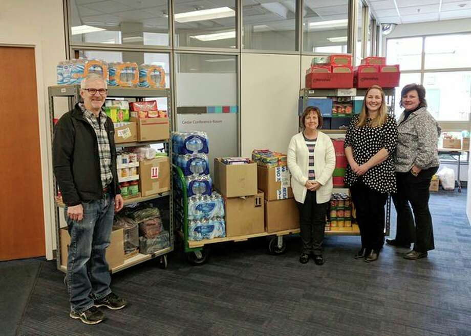 Savant Group in Midland employees donate food to the Midland County Emergency Food Pantry Network. (Photo provided/Savant)