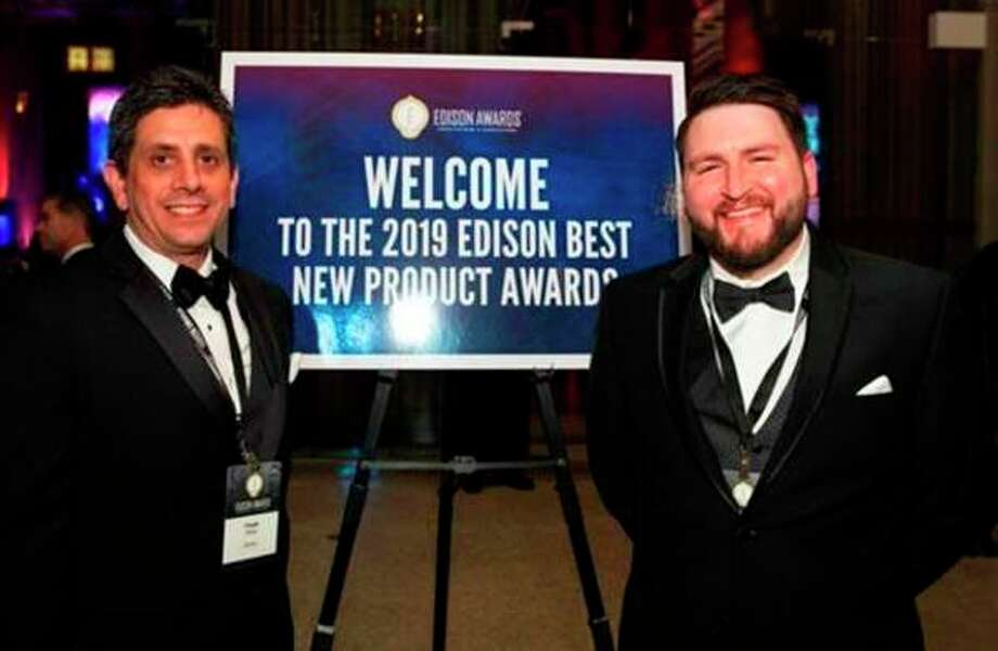 Frank Billotto and Tyler Auvil accept honors on behalf of the BETAFORCE 9050M team at the 2019 Edison Awards. (Photo provided)
