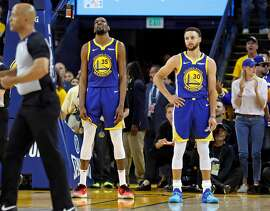 Golden State Warriors' Kevin Durant and Stephen Curry react in 4th quarter of  Los Angeles Clippers' 129-121 win during Game 5 of NBA Western Conference first round playoffs at Oracle Arena in Oakland, Calif., on Wednesday, April 24, 2019.