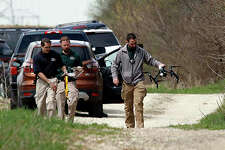 """McHenry County sheriff's officers and other law enforcement authorities search for clues in the disappearance of 5-year-old Andrew """"AJ"""" Freund."""