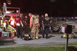 Houston police and firefighters respond to a single-vehicle crash Thursday, April 25, that killed two people in Northeast Houston. Police said the driver fell asleep at the wheel.