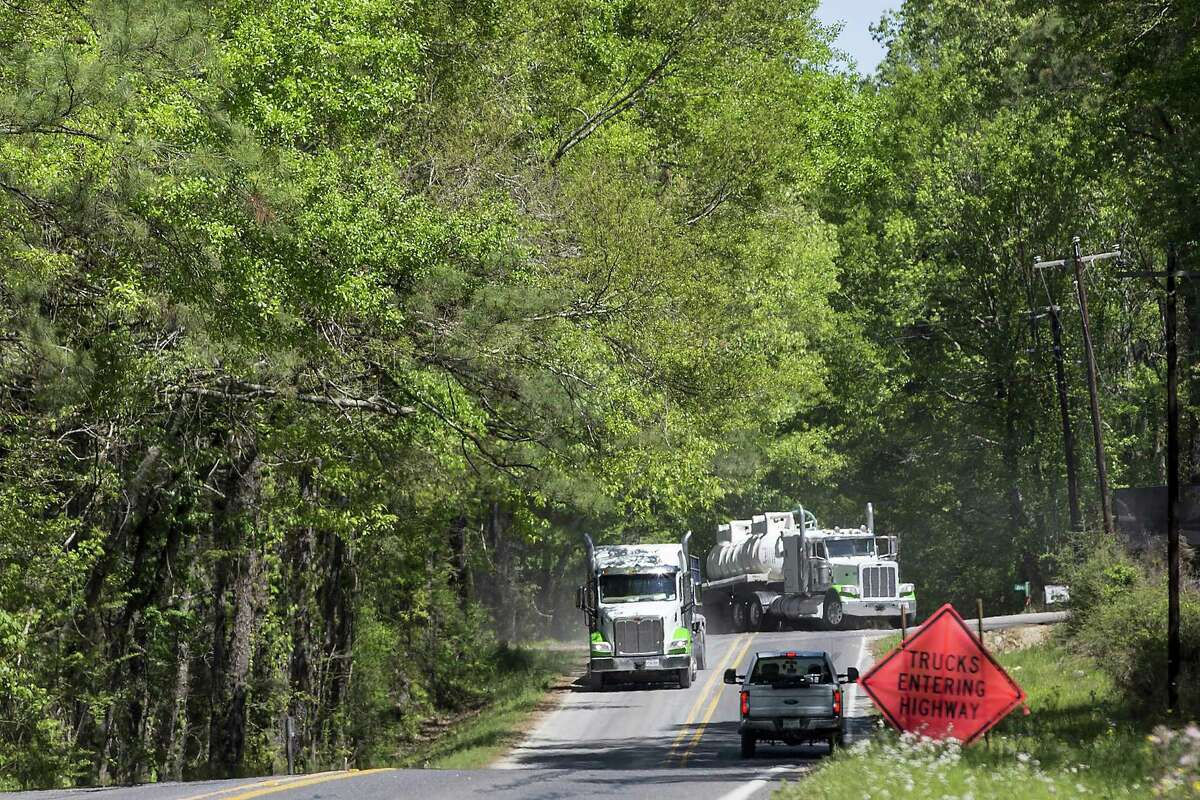 Trucks travel to and from the Erwin #1 well site on Tuesday, April 2, 2019, in St. Francisville, La. The Austin Chalk shale play that stretches from Texas into Louisiana is potentially being seen as a next big oil and gas play for Houston energy companies.