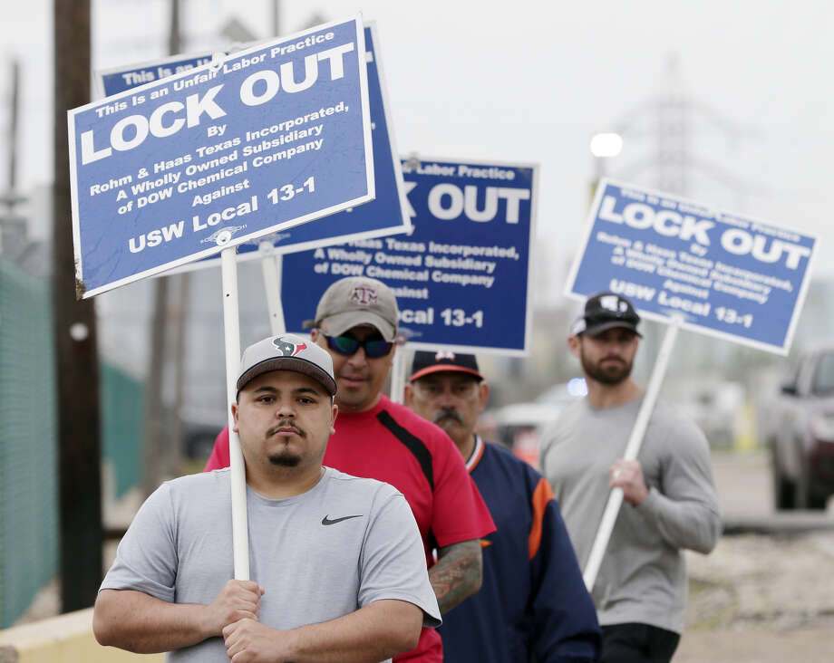 (From left) Junior Ramirez, Phillip Gomez Ernest Zehoyos and Colby Townlee walk the picket line for Local 13-1 of the United Steel Workers union outside of the DOW Chemical facility at 1800 Tidal Road Wednesday, Apr. 24, 2019 in Deer Park, TX.