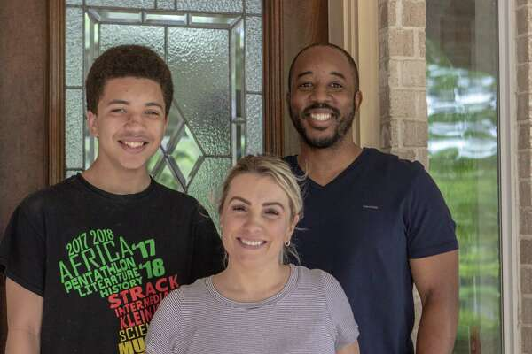 837f4ea7ff6 1of7The Ayers family stands near their doorway Saturday, April 6, 2019 at  their home in Conroe. Chris Ayers, right, and Mandy Ayers, center, recently  sold ...