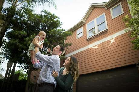 Shaina and Josh Pherigo and their 1-year-old daughter, Bailey, recently bought their first home in the Shady Acres neighborhood of Houston, Monday, April 22, 2019. The home was built ten-years-ago, and it was on the market for a year before the Pherigo's purchased it as their first home earlier this year.