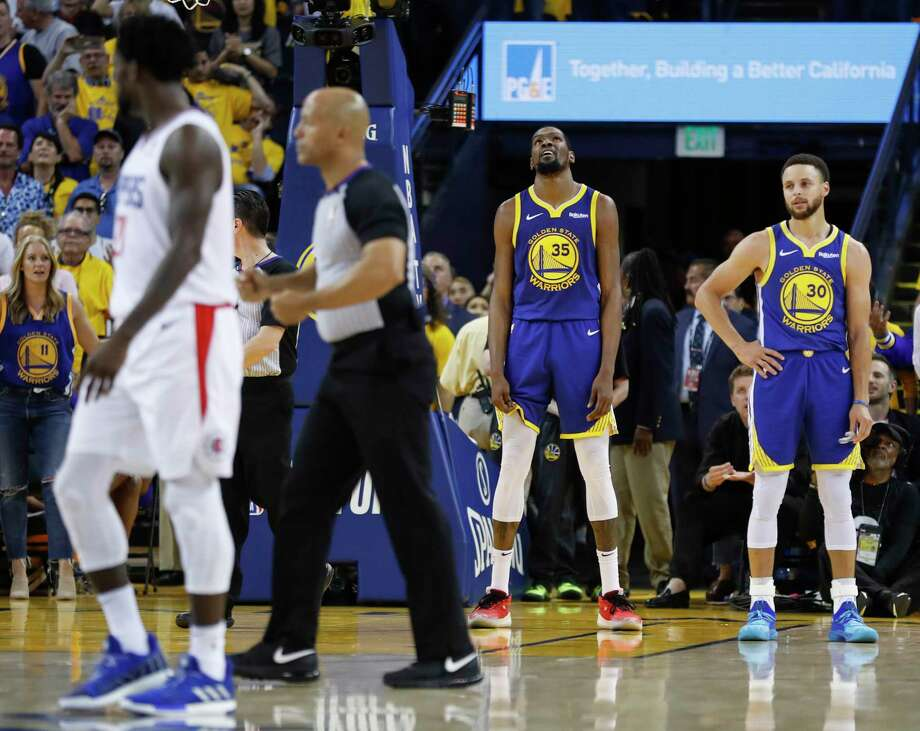 Golden State Warriors Kevin Durant and Stephen Curry are seen during a break in the action in the fourth quarter during game 5 of the Western Conference Playoffs between the Golden State Warriors and the Los Angeles Clippers at Oracle Arena on Wednesday, April 24, 2019 in Oakland, Calif. Photo: Scott Strazzante, The Chronicle / online_yes